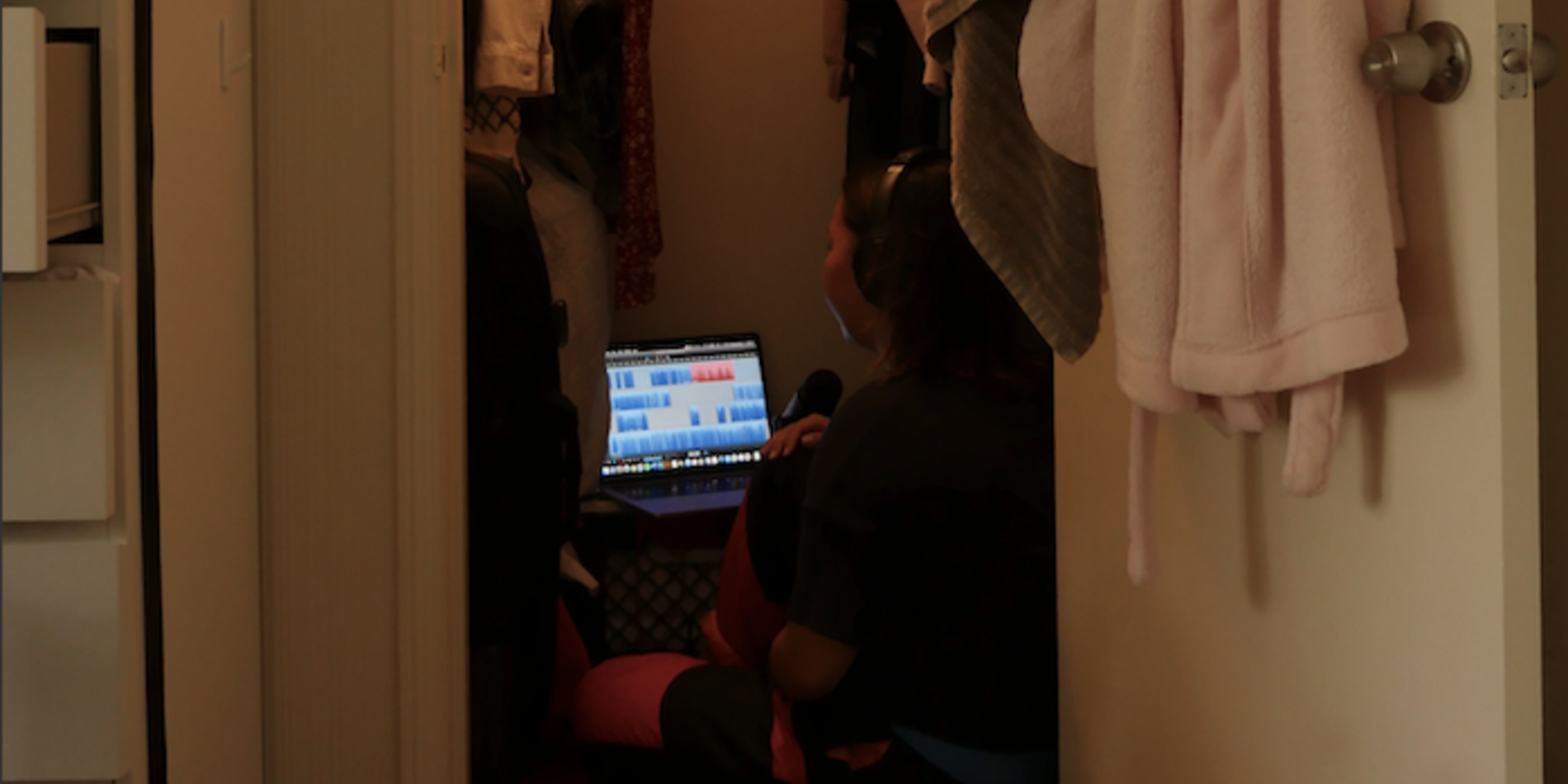 Aja in her closet making the podcast
